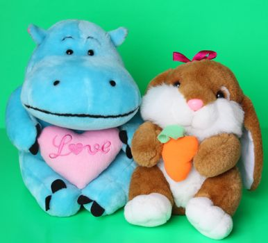 Soft toys hippo with pink heart and hare with carrot