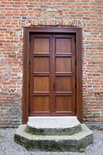 Wooden front door - the picture was taken in Lithuania, castle Raudone.