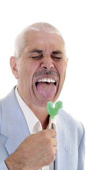 Senior man lick the candy