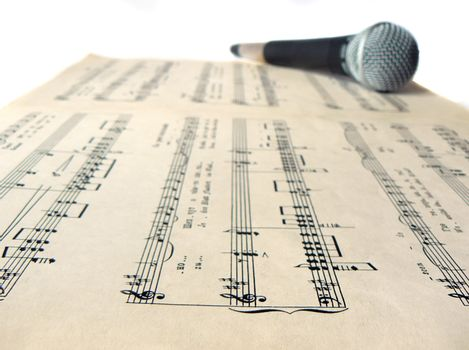microphone on sheet music of romance