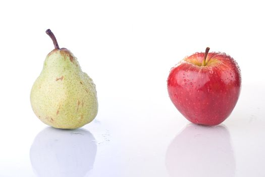 Red apple and Pear, with water drops, on white background.