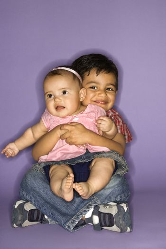 Hispanic female baby and male child portrait.