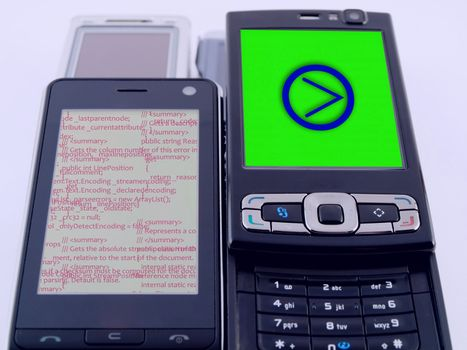 Two Modern Mobile Phones PDA Showing Source Code Programming