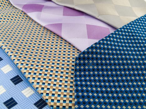 Close Up Neck Ties Showing Silk Pattern on Rich Cloth