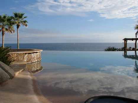 Infinity pool in a perfect vacation setting over-looking the ocean