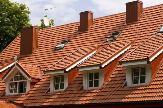 Red tile roof and gabled dormer windows in Palanga, resort of Lithuania