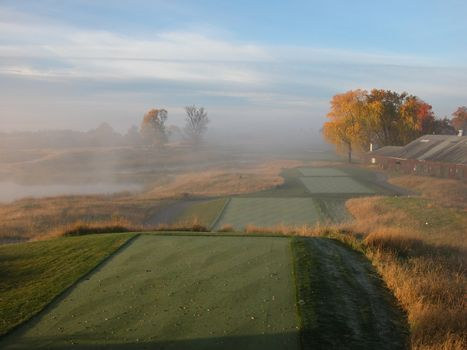 Perfectly groomed tee boxes on a steamy morning