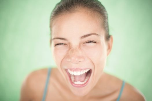 Happy woman screaming closeup