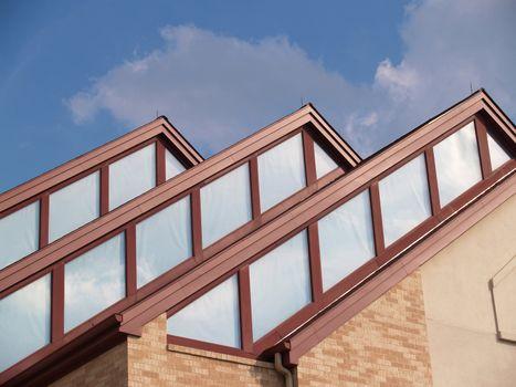 three roof peaks on a modern building