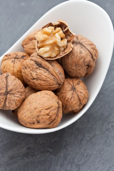 Walnuts in a white dish