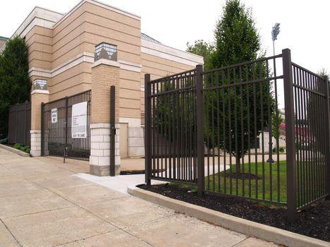tall black gate entrance to  football stadium