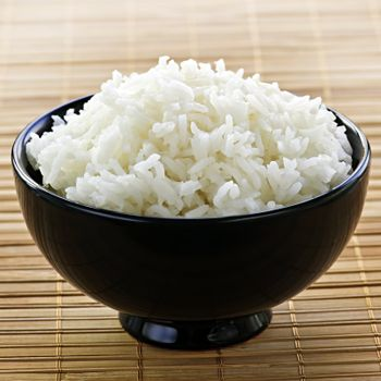 White steamed rice in black round bowl