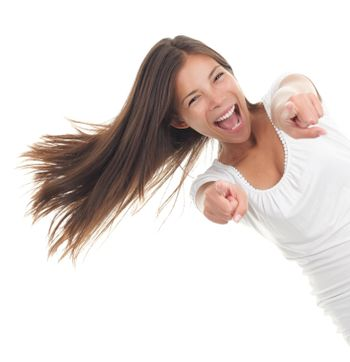 Pointing cheerful woman
