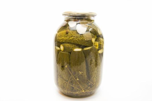 Pickles in a jar on white background