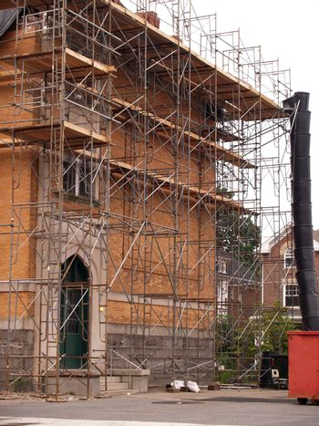 scaffolding by the exterior of a building being remodeled