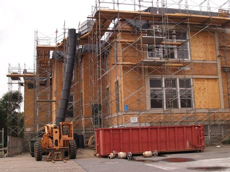 scaffold by the exterior of a large building under renovation