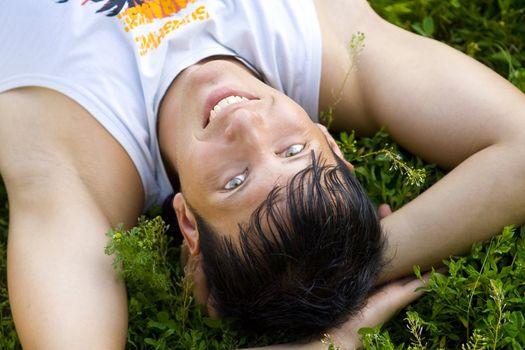 man lie on grass