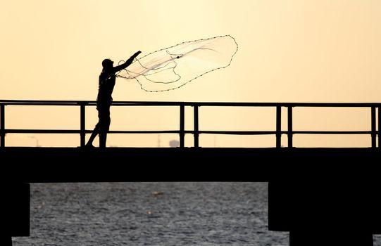 Fisherman tossing net