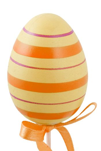 a yellow and orange easter egg isolated on the white background