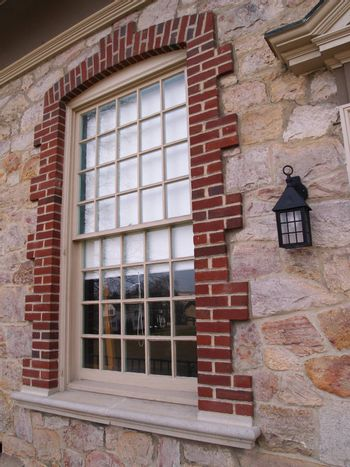 closeup of a window on a  stone building