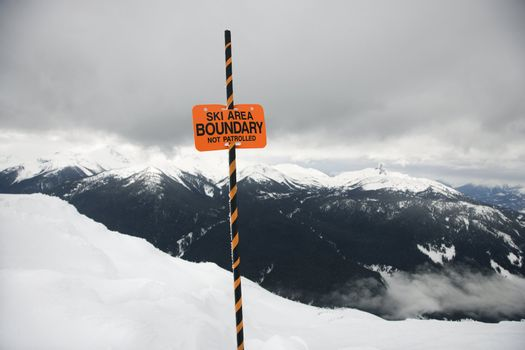 Ski trail boundary sign.
