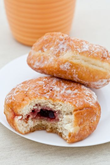 Jam donut with bite taken out