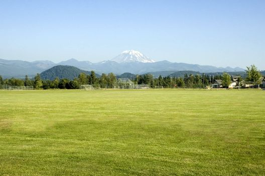 Mount Rainier looms large over the sports fields in this rural Washington town.