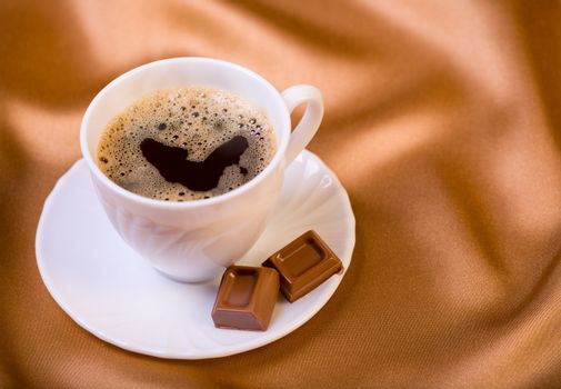 Cup of fresh aromatic coffee