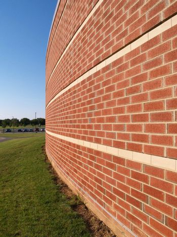 abstract perspective of a rounded exterior brick wall