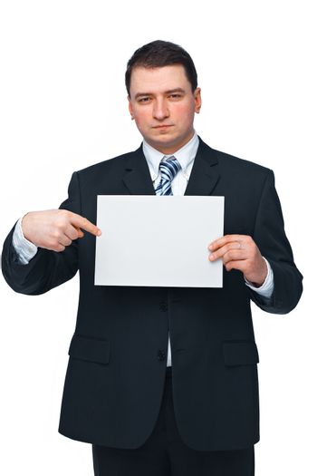 A successful business executive holding and pointing at an empty billboard
