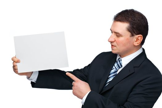 A successful happy business executive holding and pointing at an empty billboard