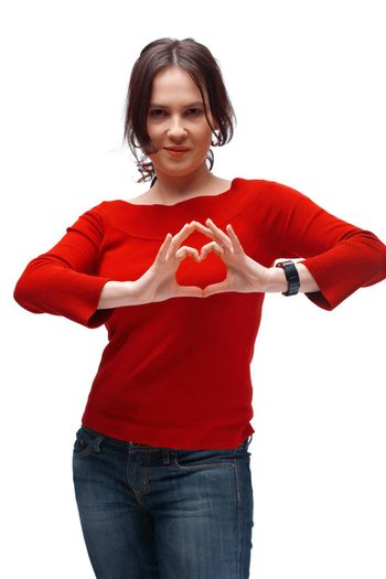 Portrait of a girl showing heart symbol isolated over white background