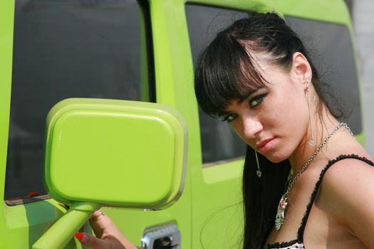 The girl in bikini poses at the smart car
