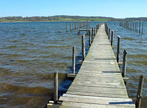 Wooden pier jetty and clear sea water - Funen Denmark