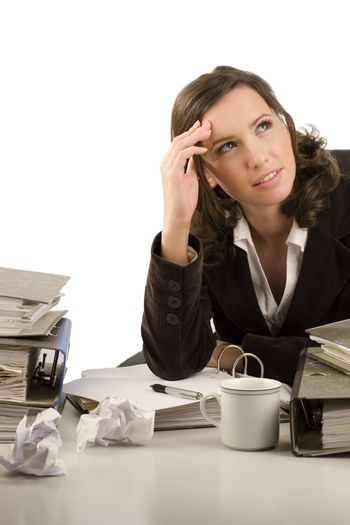Pensive businesswoman sitting at a desk in an office