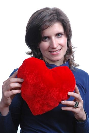 pretty young woman holding a Valentines heart