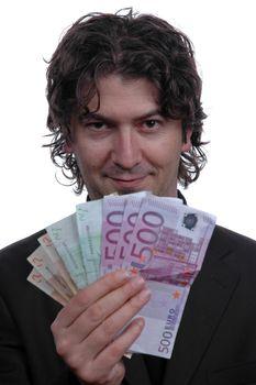 Business man holding money isolated on white