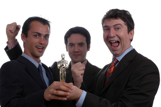 three businessman holding oscar award