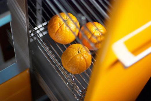 Orange in kitchen in fridge