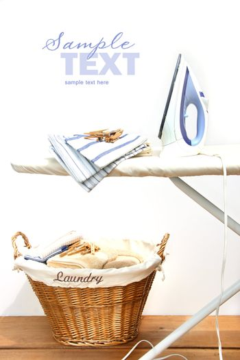 Ironing board with laundry