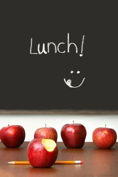 Apples on top of school desk2