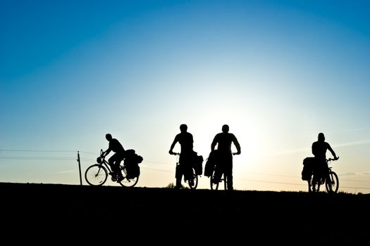 Bicycle tourists silhouette