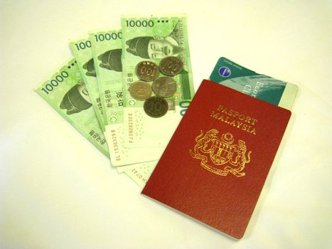 a malaysia passport and korean currency