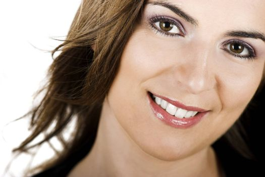 Close-up portrait of a beautiful young woman with a cute smile