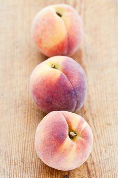 Three peaches in a row