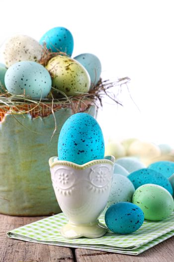 Easter scene with turquoise speckled egg in cup