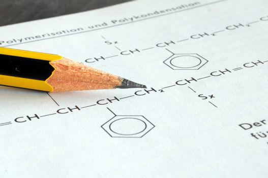 chemical or chemistry education with pen formula book and paper