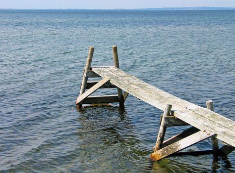 Small wooden footbridge pier Fons Beach Funen Denmark