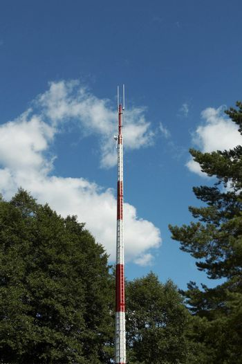 A red and white communications tower
