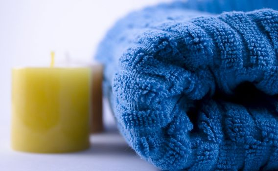 Blue towel and two yellow candles